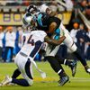 Carolina Panthers' quarterback Newton is sacked by Denver Broncos' Ware during the third quarter of the NFL's Super Bowl 50 football game in Santa Clara