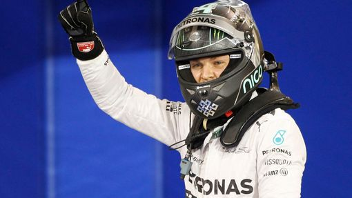 Mercedes Formula One driver Nico Rosberg of Germany celebrates after taking pole position at the qualifying session of the Bahrain F1 Grand Prix at the Bahrain Internatio