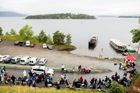 Youths stand in a line to wait for the MS Thorbjorn ferry to take them to Utoya island