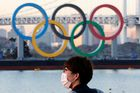 FILE PHOTO: A man wears a protective mask amid the coronavirus disease (COVID-19) outbreak in front of the giant Olympic rings in Tokyo, Japan, January 13, 2021. REUTERS/