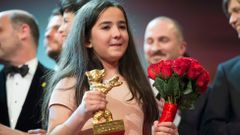 The niece of Iranian film director Panahi appears on stage with jury members and prize winners during awards ceremony at 65th Berlinale International Film Festival in Berlin