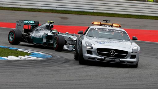 The safety car drives in front of Mercedes Formula One driver Nico Rosberg of Germany before the German F1 Grand Prix at the Hockenheim racing circuit July 20, 2014. REUT