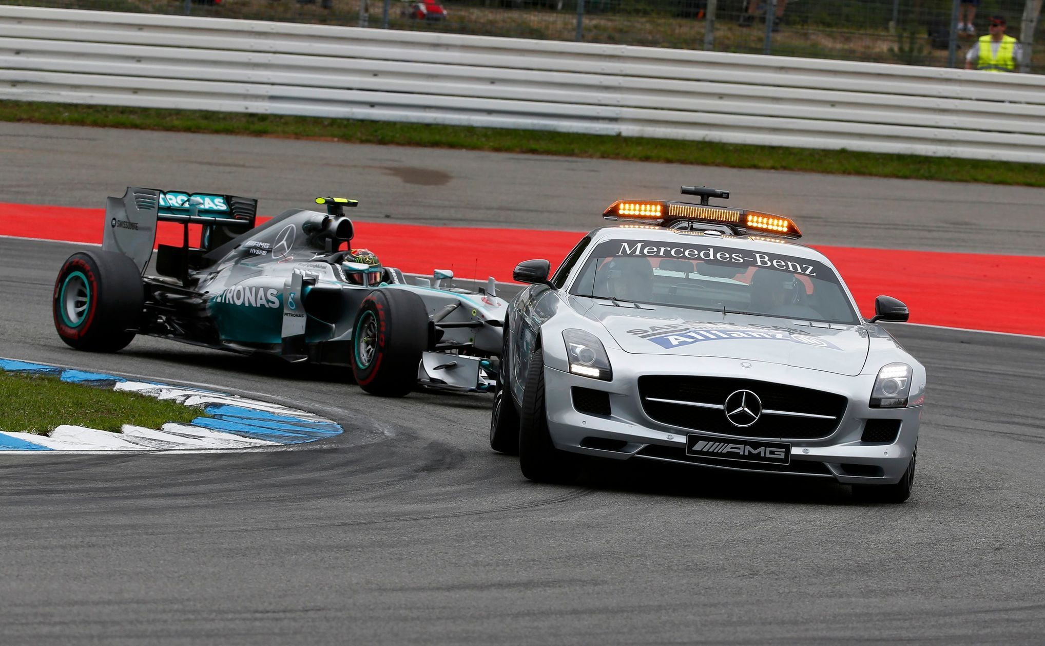 The safety car drives in front of Mercedes Formula One driver Nico Rosberg of Germany before German F1 Grand Prix at Hockenheim
