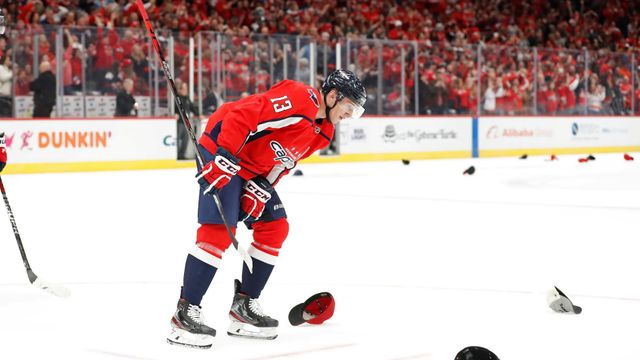 Nov 3, 2019; Washington, DC, USA; Washington Capitals left wing Jakub Vrána (13) skates to the bench after scoring a hat trick goal against the Calgary Flames in the seco