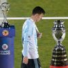 Argentina's Lionel Messi walks with his silver medal past the Copa America trophy during the presentation ceremony after Chile defeated his team in the Copa America 2015 final soccer match at the Nati