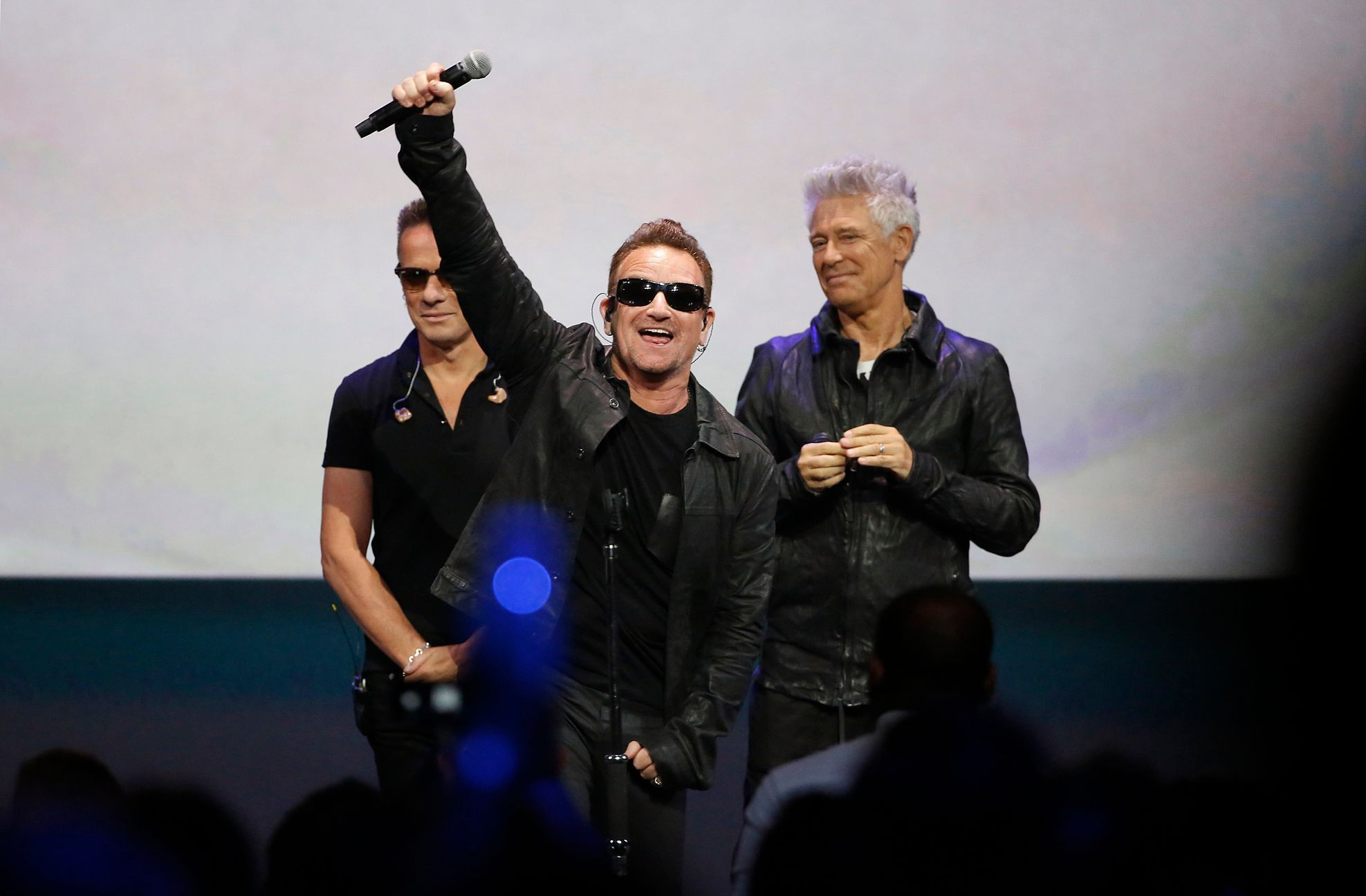 Bono of Irish rock band U2 gestures to the audience after performing at an Apple event at the Flint Center in Cupertino