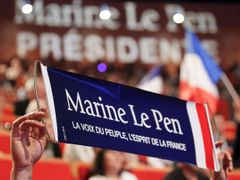 "A banner which reads ""Marine Le Pen, People's voice, France's spirit"" is seen during a meeting of Marine Le Pen in Lyon"