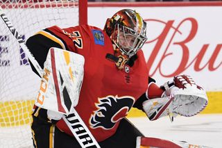 Mar 10, 2019; Calgary, Alberta, CAN; Calgary Flames goalie David Rittich (33) stops a shot from Las Vegas Golden Knights at Scotiabank Saddledome. Flames won 6-3. Mandato