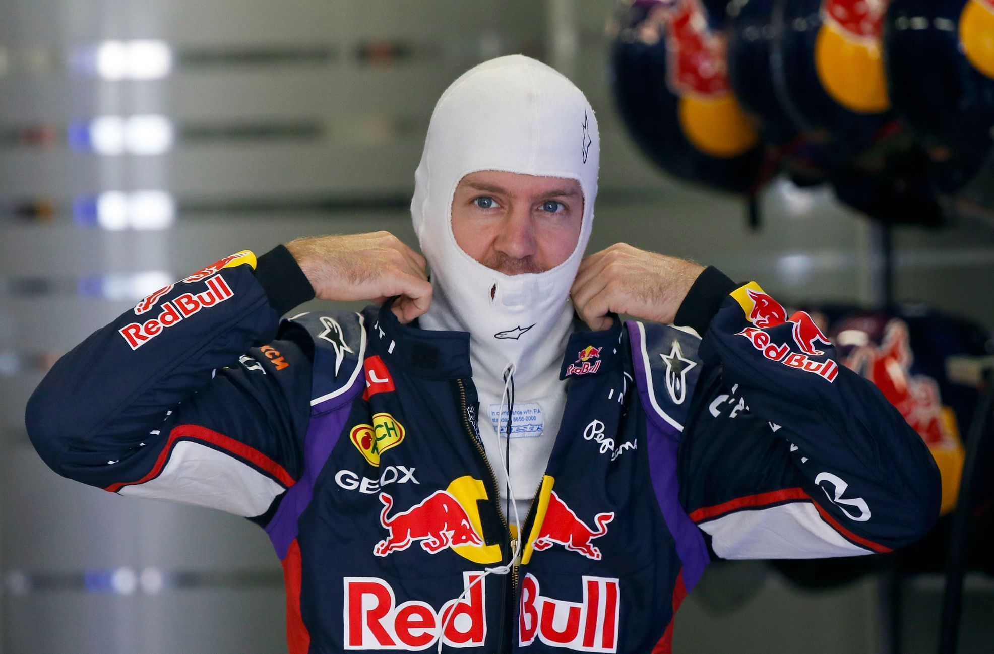 Red Bull Formula One driver Sebastian Vettel of Germany prepares for the third free practice session at the Russian F1 Grand Prix in the Sochi Autodrom circuit