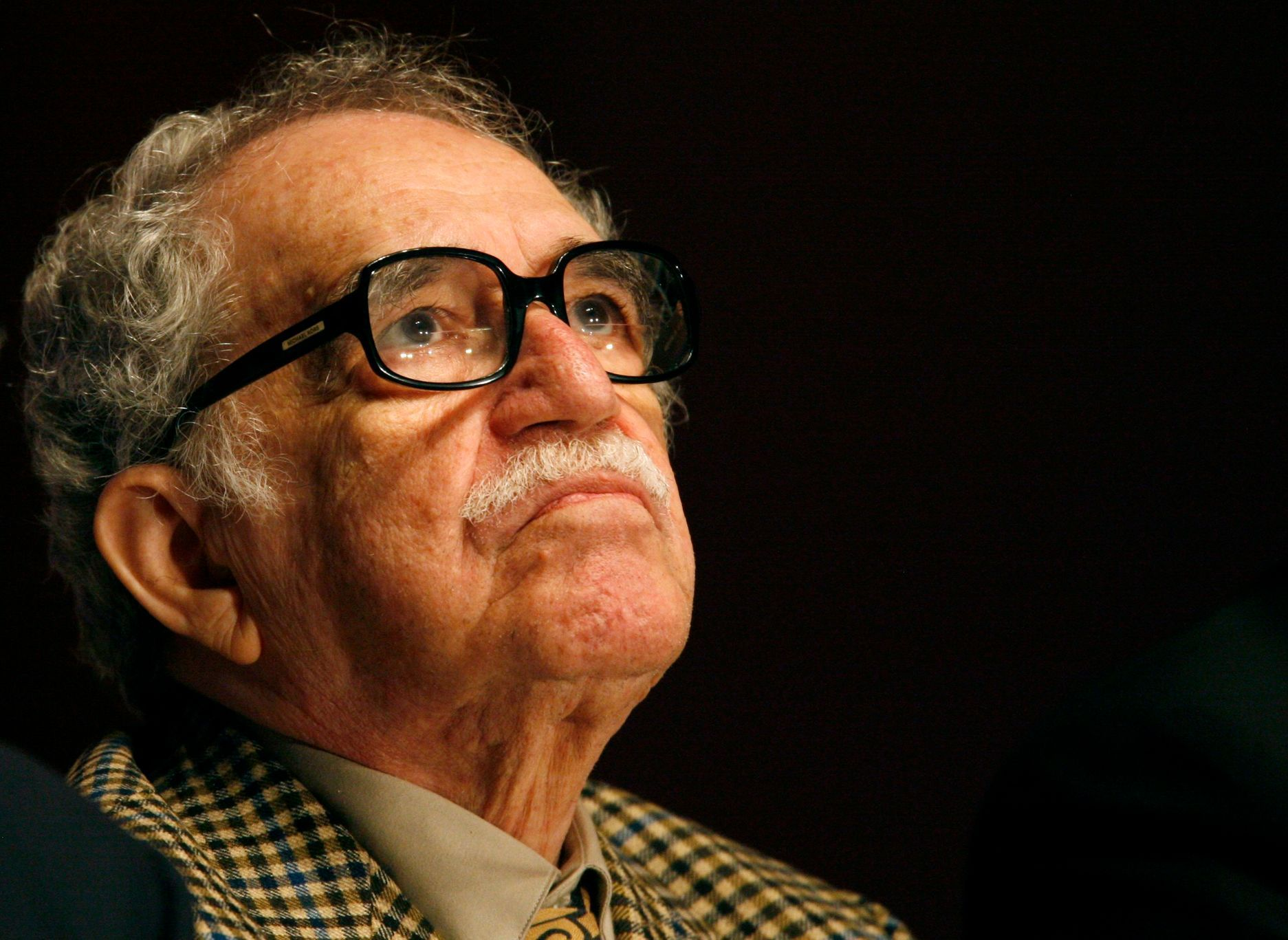 Colombian Nobel Prize laureate Gabriel Garcia Marquez listens to a speech during the New Journalism Prize awards ceremony at the Museum of Contemporary Art (MARCO) in Monterrey