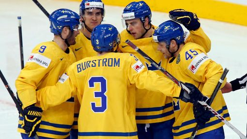 Sweden's Joakim Lindstrom (2nd R) celebrates his goal against the Czech Republic with team mates during the first period of their men's ice hockey World Championship bron