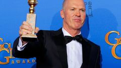 "Michael Keaton poses backstage with his award for Best Actor in a Motion Picture, Musical or Comedy for his role in ""Birdman"" at the 72nd Golden Globe Awards in Beverly Hills"