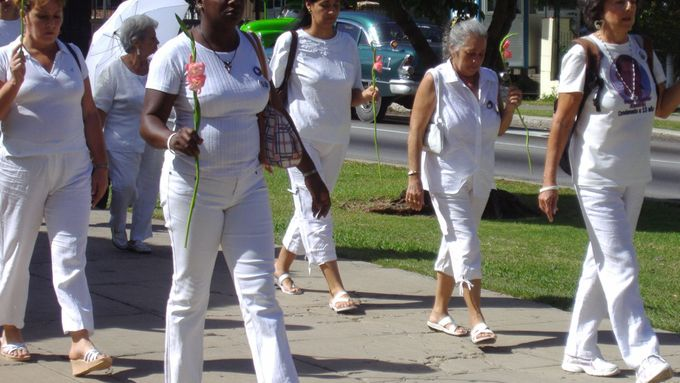Ladies in white in the streets of Havana