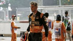 Force India Formula One driver Hulkenberg of Germany walks from the track after crashing during the Singapore F1 Grand Prix