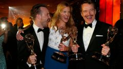 Aaron Paul, Anna Gunn and Bryan Cranston attend the Governors Ball for the 66th Primetime Emmy Awards in Los Angeles
