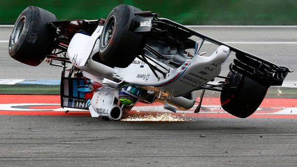 Williams Formula One driver Massa of Brazil crashes with his car in the first corner after the start of the German F1 Grand Prix at the Hockenheim racing circuit