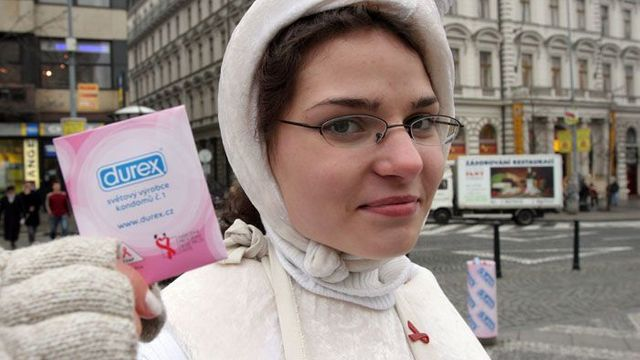 An activist donning a sperm-like outfit offers condoms to passersby on World AIDS Day in Prague
