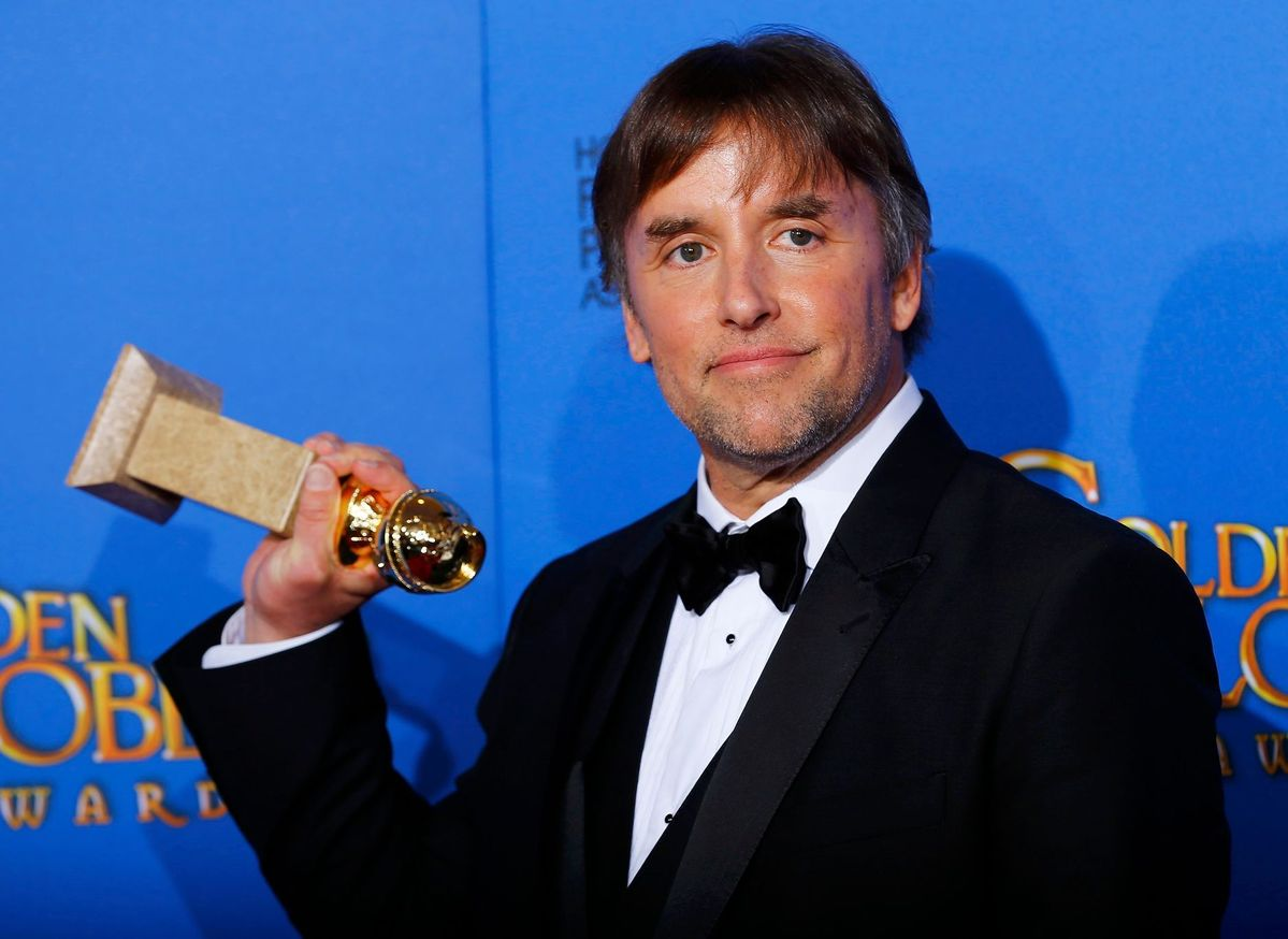 Richard Linklater poses with his award during the 72nd Golden Globe Awards in Beverly Hills