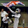 Mercedes Formula One driver Lewis Hamilton of Britain waves the Union flag, commonly known as the Union Jack, in celebration as he enters the pit lane after winning the Abu Dhabi F1 Grand Prix at the