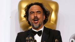 """Birdman"" Director Alejandro Inarritu poses with the Oscars for Best Director, Best Original Screenplay and Best Picture backstage at the 87th Academy Awards in Hollywood"