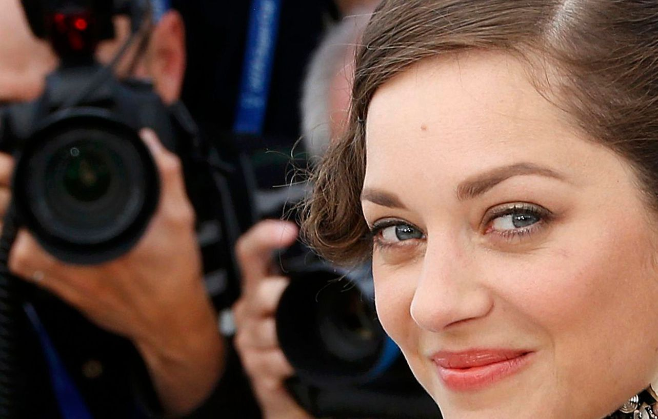 "Cast member Marion Cotillard poses during a photocall for the film ""Deux jours, une nuit"" in competition at the 67th Cannes Film Festival in Cannes"