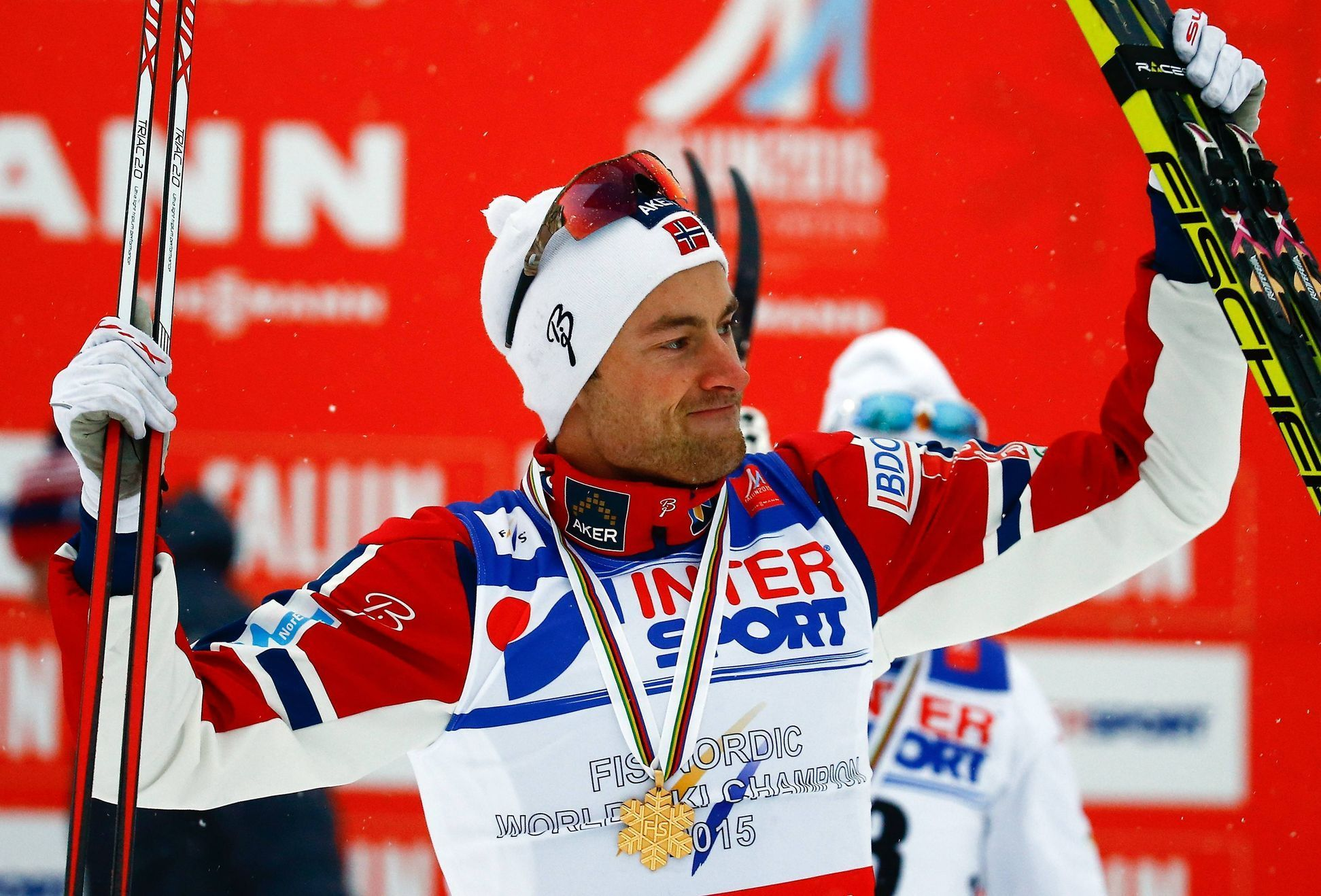 Norway's Northug celebrates winning the men's cross country 50 km mass start classic race at the Nordic World Ski Championships in Falun