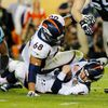 Denver Broncos' quarterback Manning is sacked by Carolina Panthers' Ealy as Broncos' Harris falls on Manning in the third quarter during the NFL's Super Bowl 50 football game in Santa Clara