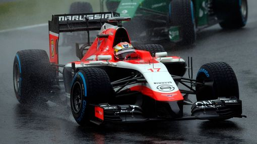 Marussia Formula One driver Jules Bianchi of France drives in front of Caterham Formula One driver Kamui Kobayashi of Japan during the Japanese F1 Grand Prix at the Suzuk