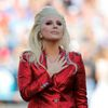 Lady Gaga places her hand over her heart after singing the U.S. National Anthem before the start of the NFL's Super Bowl 50 football game between the Carolina Panthers and the Denver Broncos in Santa