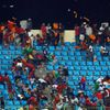 Equitorial Guinea fans react as a police helicopter hovers above the stand during the African Cup semi-final match against Ghana in Malabo