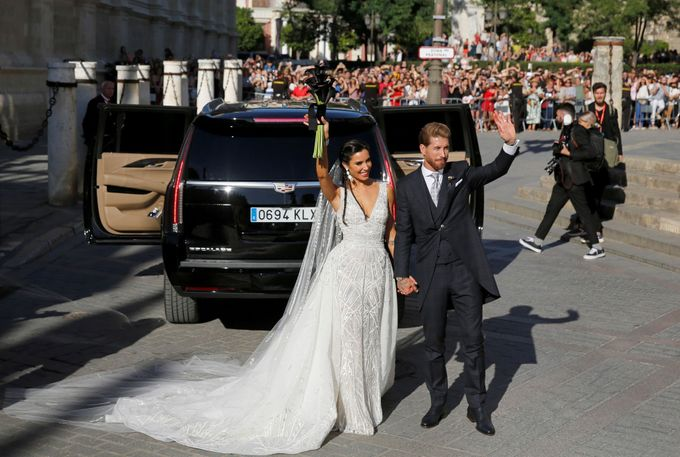 Real Madrid captain Sergio Ramos and his wife Pilar Rubio wave after their wedding at the cathedral in Seville, Spain June 15, 2019. REUTERS/Marcelo del Pozo