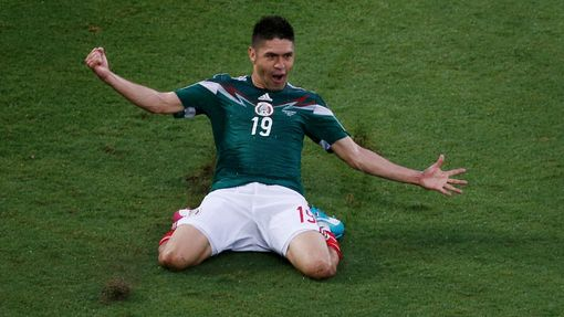 Mexico's Oribe Peralta celebrates after scoring a goal during their 2014 World Cup Group A match against Cameroon at Dunas arena in Natal June 13, 2014. REUTERS/Carlos Ba