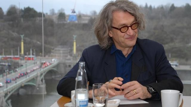 Eco-friendly Win Wenders came to Prague by train saving the nature and energy and money