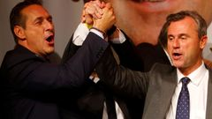 Presidential candidate Hofer of the Austrian Freedom Party (FPOe) and party head Strache sing a song during party celebrations after Austrian presidential election in Vienna