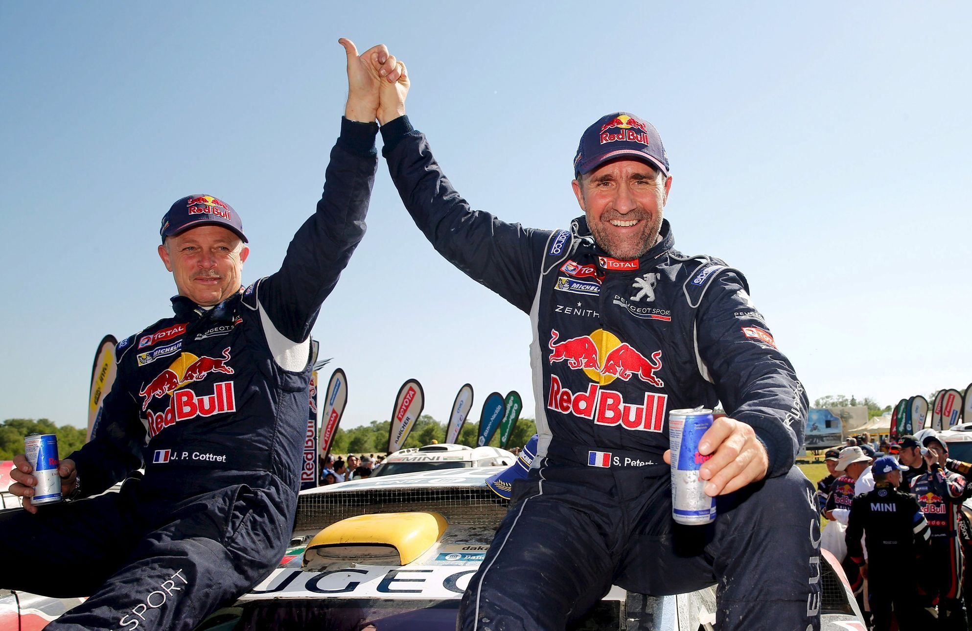 Peugeot driver Peterhansel of France and co-pilot Cottret of France react at the end of the 13th and final stage of the Dakar Rally 2016 in Cordoba province