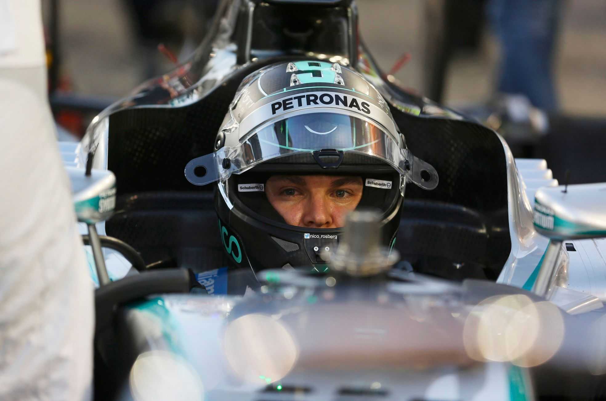 Mercedes Formula One driver Nico Rosberg of Germany sits in his car before the start of the Bahrain F1 Grand Prix at the Bahrain International Circuit (BIC) in Sakhir