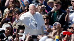 Pope Francis waves as he leads the Easter Mass in Saint Peter's Square at the Vatican