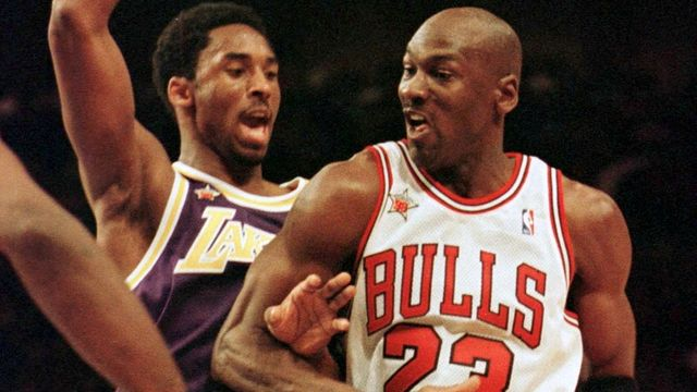 FILE PHOTO: Chicago Bulls Michael Jordan, (R) playing for the Eastern Conference, moves past Los Angeles Lakers Kobe Bryant of the Western Division, in the second half of