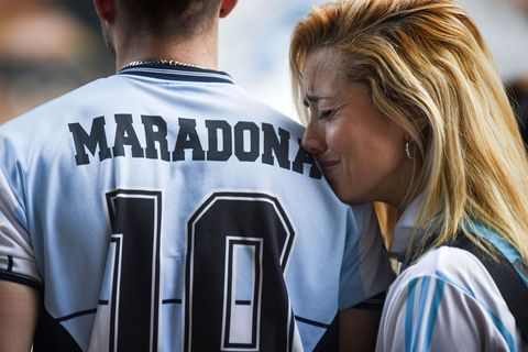 People gather to mourn the death of soccer legend Diego Maradona, outside the Diego Armando Maradona stadium, in Buenos Aires