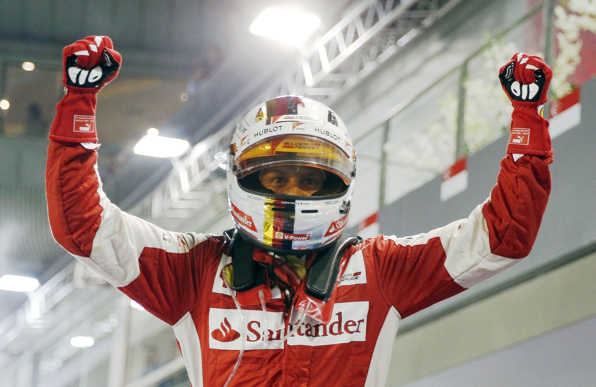 Ferrari Formula One driver Vettel of Germany reacts after winning the Singapore F1 Grand Prix