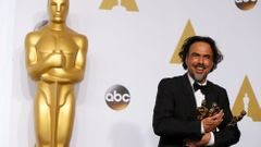 Director Alejandro Inarritu poses with the Oscars for Best Director, Best Original Screenplay and Best Picture at the 87th Academy Awards in Hollywood, California