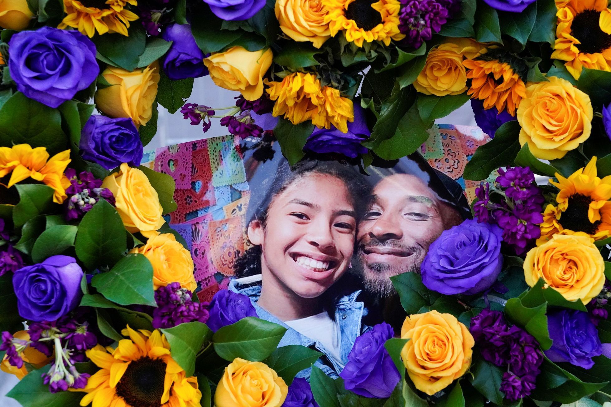 "Flowers and photos of Kobe Bryant and his daughter Gianna ""Gigi"""