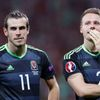 Wales' Gareth Bale and Chris Gunter react after the game