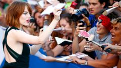"U.S. actress Stone signs autographs during the red carpet for the movie ""Birdman or (The unexpected virtue of ignorance)"" at the 71st Venice Film Festival"