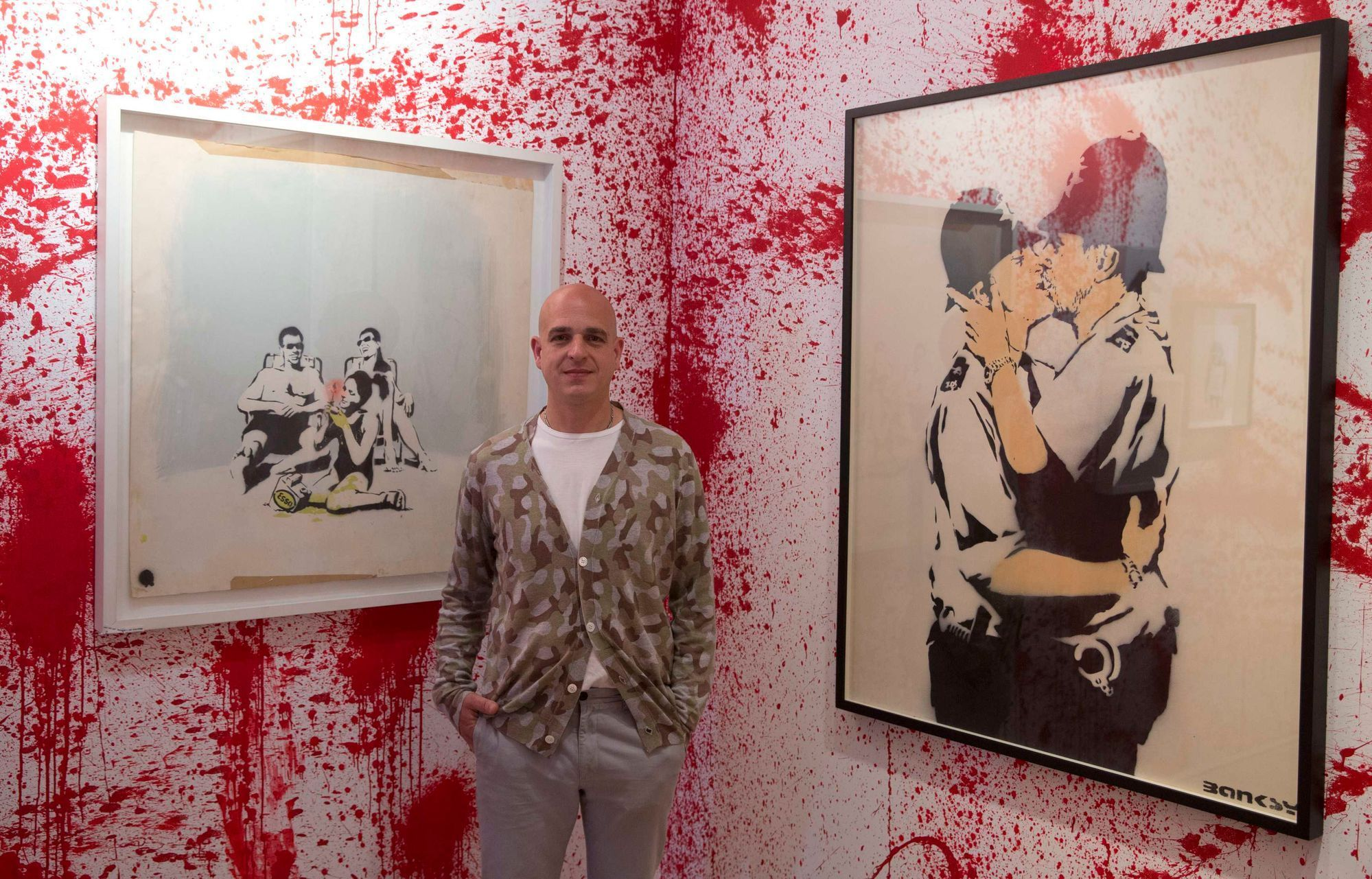 Curator Steve Lazarides poses for photograph at the Banksy: The Unauthorised Retrospective at Sotheby's S2 Gallery in London