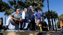 "Cast members Lundgren, Statham, Ford, Gibson, Rousey, Stallone and Snipes pose on a tank as they arrive on the Croisette to promote the film ""The Expendables 3"" during the 67th Cannes Film F"