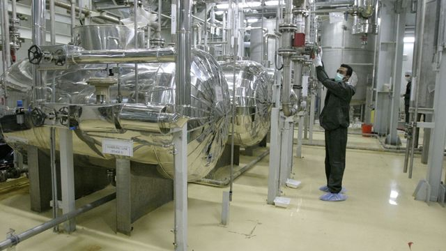 An Iranian technician works in the Uranium Conversion Facility (UCF) in Isfahan, Iran, on November 20, 2004.