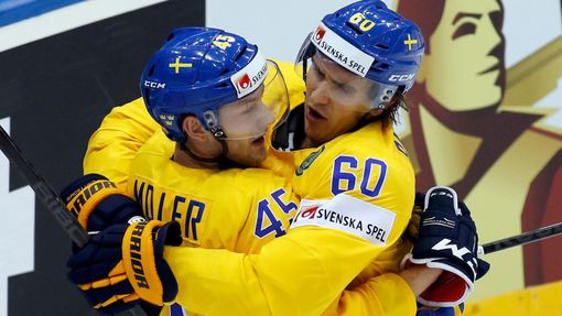 Sweden's Oscar Moller (L) celebrates his goal against the Czech Republic with team mate Mikael Backlund during the first period of their men's ice hockey World Championsh