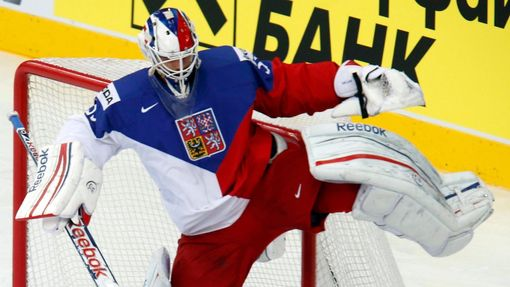 Goalie Alexander Salak of the Czech Republic (top) avoids a collision with Sweden's Dick Axelsson (bottom) during the first period of their men's ice hockey World Champio