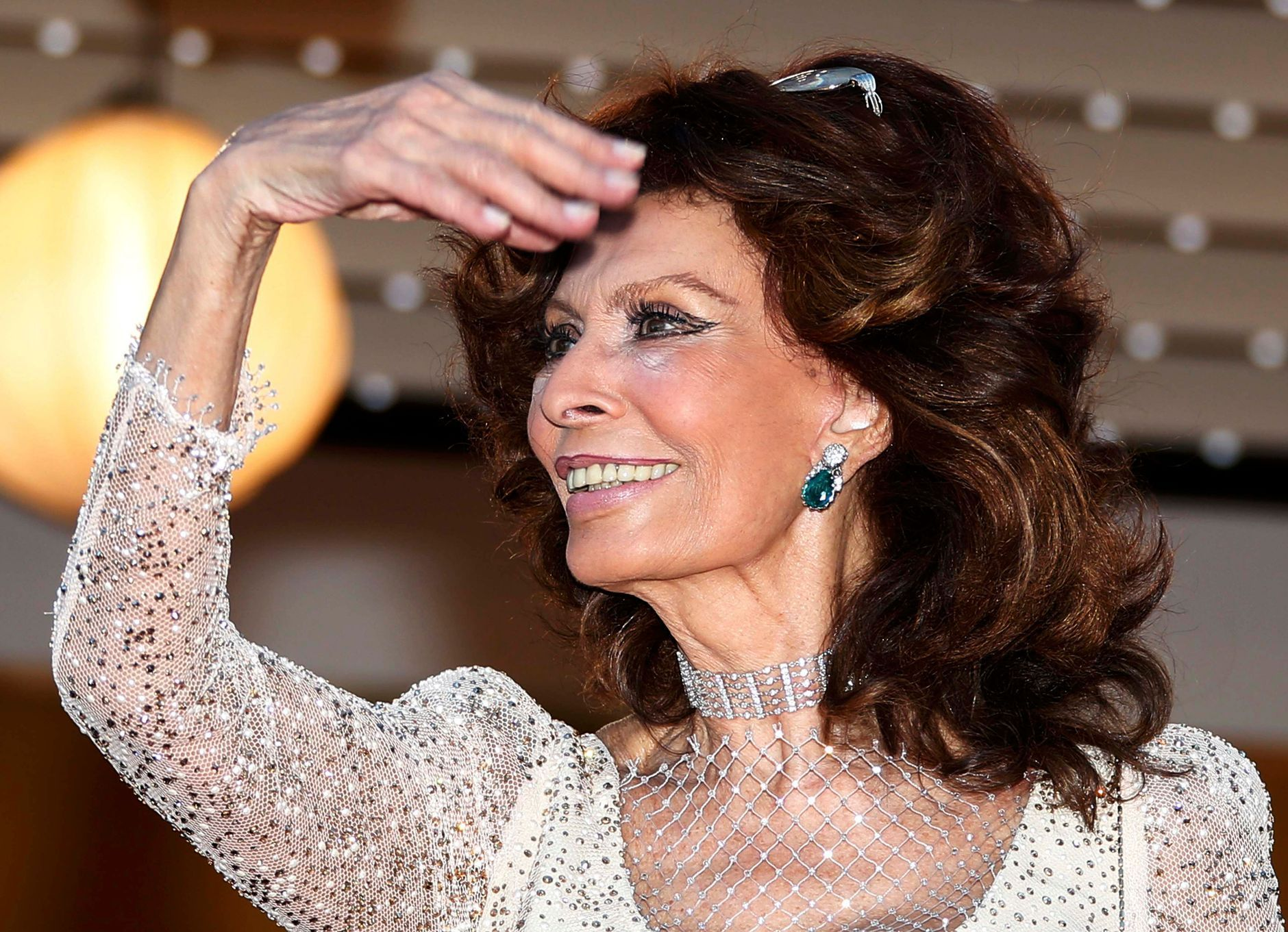 "Actress Sophia Loren poses on the red carpet as she arrives for the screening of the film ""Deux jours, une nuit"" at the 67th Cannes Film Festival in Cannes"